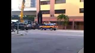 traffic light falls over police car