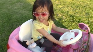 Cute little girl drives Baby Mickey in her pink car! Part 1 /Pink Power Wheels Ride   EllieBellyToys