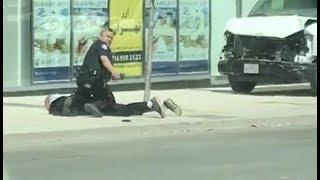 Toronto Police Confront And Arrest Man After Van Hits Pedestrians