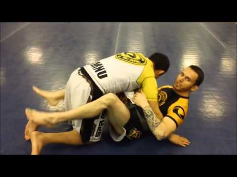 Hook Flip Sweep from Butterfly Guard Image 1