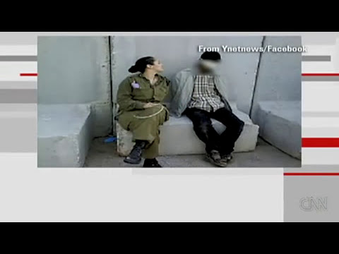 On Facebook, Israeli soldier poses with bound Abu Ghraib 2 - Israeli War Crimes