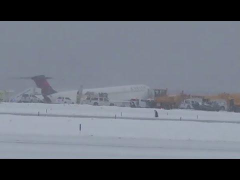 Delta passenger plane skids off runway at New York's LaGuardia Airport