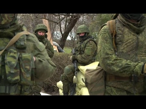 Russian forces take over Crimean military bases