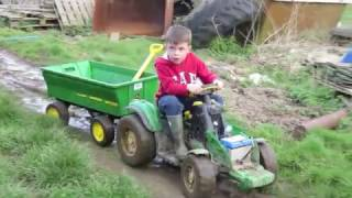 Kids playing on tractors, digging & shovelling mud, children on the farm.