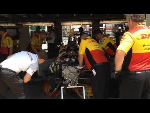 Ryan Hunter-Reay's crew working on wrecked car