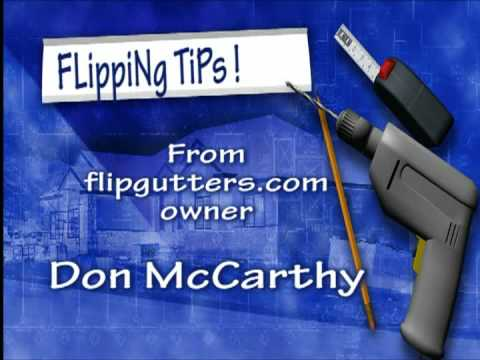 Homeowners clean their gutters from the safety of the GROUND with flipgutters.
