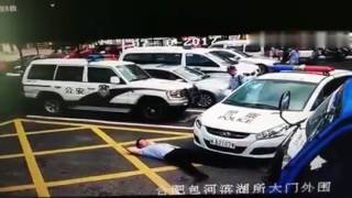 Scammer lies in front of vehicle only to find it's a cop car