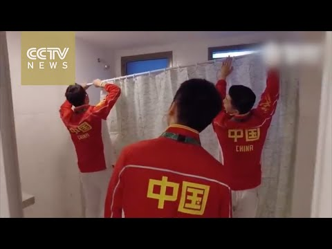 Footage: Chinese athletes fit shower curtain in Olympic Village