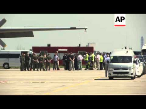 Plane carrying bodies of MH17 victims departs for Netherlands