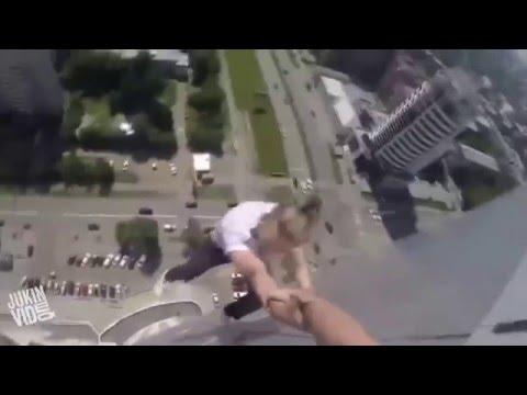 JukinVideo   Dudes Do Stunts Off the Edge of Skyscraper fbdown net