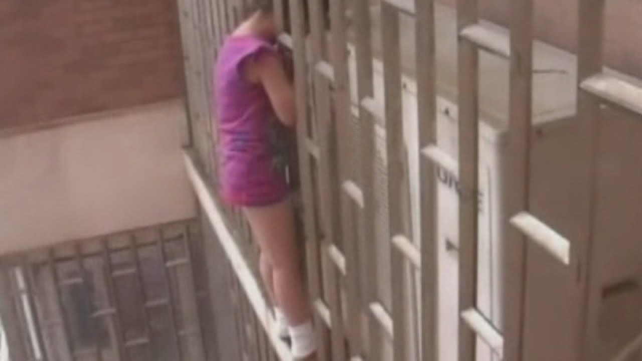 Chinese Girl Rescued Hanging From Railings On Skyscraper