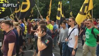 1:04 German Cops Remove Antifa  'German' Jew's Hoodie