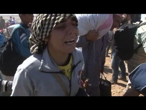 Turkey reopens border to Syrian Kurds fleeing IS group