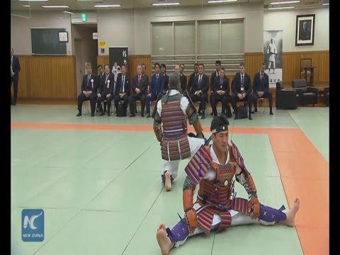 Raw: Putin And Abe Watch Judo Display In Tokyo