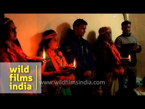 Childless couples pray with lighted earthen lamps for fertility