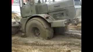 Russian monster tractor Kirovets K-700 rides through the mud