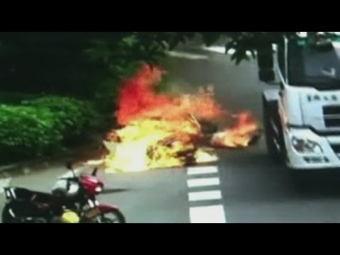 Dramatic Cctv: Chinese Motorcyclist Set On Fire After Lorry Crash video