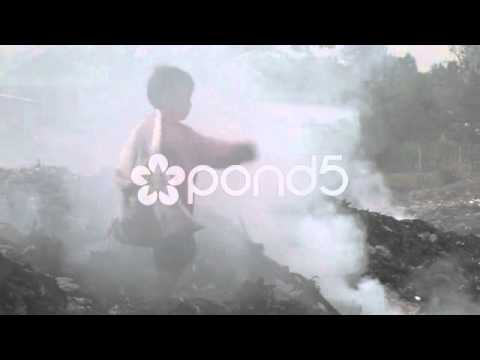 Pond5 Stock Footage - Boy Works in Dump Phnom Penh, Asia