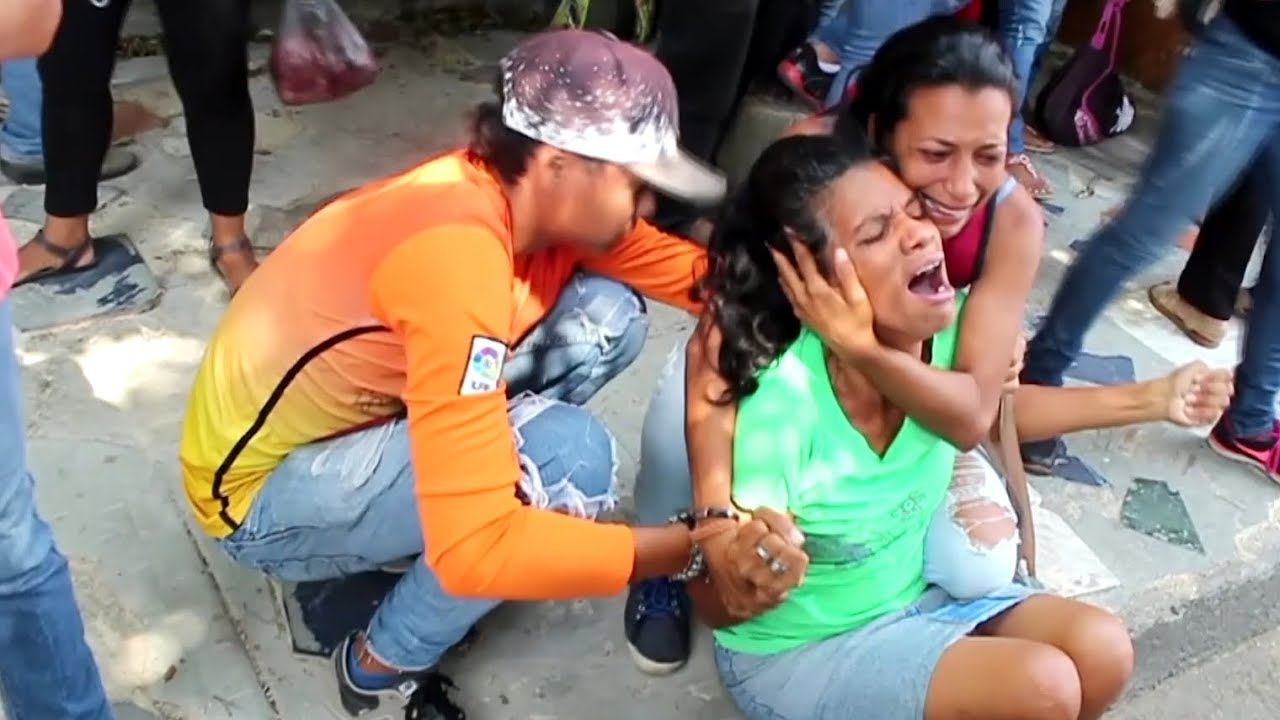 Relatives mourn as fire in cells of Venezuelan police station kills 78