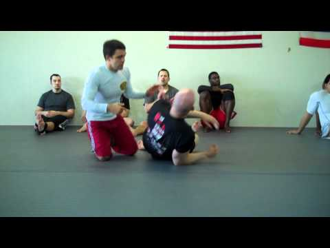North-South Arm Triangle Escape - No-Gi with Robson Moura Image 1