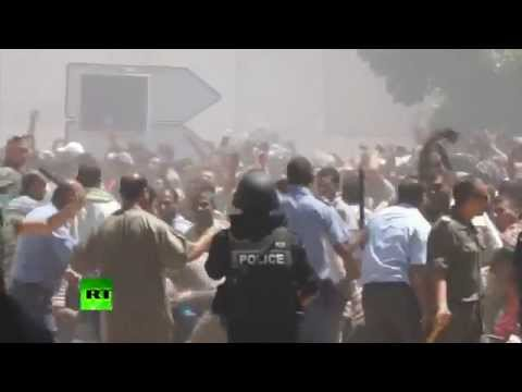 RAW: 2 die as hundreds flee from Libya's descent into militia wars