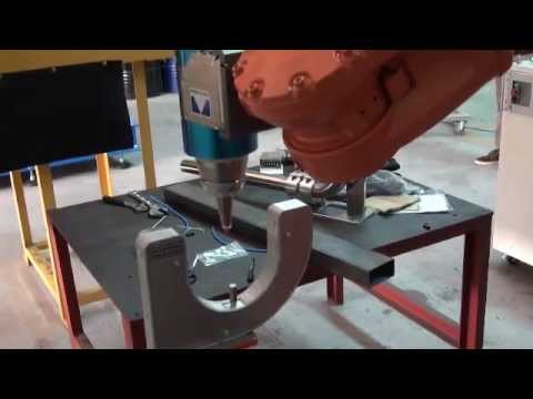 Robotic Laser Cutting Head with Bull's Eye TCP Calibration