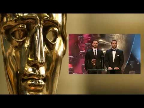 Henry Cavill and Chris Evans present BAFTA award to Julianne Moore