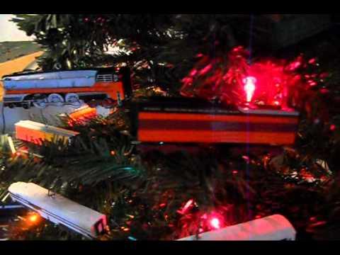 Train ornaments on tree. Hallmark Lionel collectibles.