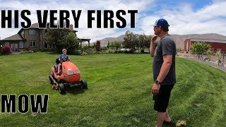 BEGINNER lawn mowing. Teaching a young boy