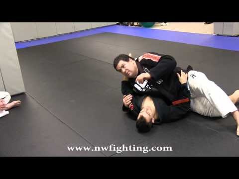 Brazilian Jiu-Jitsu Portland - Rigan Machado - Controlling the Arm from Side-Control Image 1