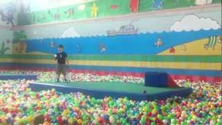 Remy jumps into the ball pit