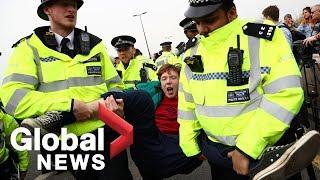 British police drag, arrest climate change activists blocking London's Waterloo bridge