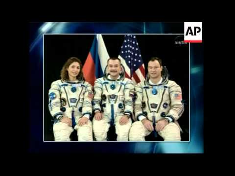 Capsule carrying new US-Russian crew, space tourist docks at ISS, reax