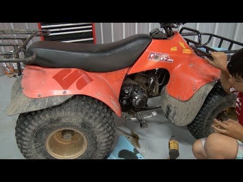 Suzuki Quadrunner Oil Filter change! PowerModz!