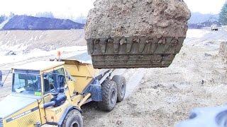 Cat 325D Excavator Loading Dumpers With Overburden