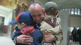 Dad surprises sons... all scouts, they thought they were at the airport to earn a badge