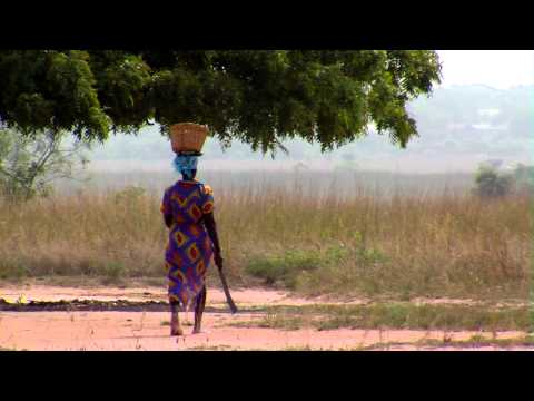 Royalty Free Stock Footage of African woman walking with a machete.