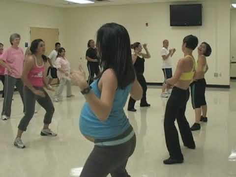 Pregnant Angie teaching Zumba