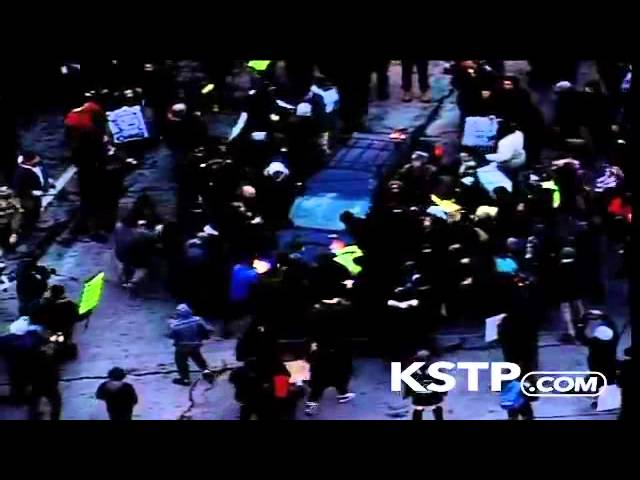 RAW: Car Drives Through Protest in Minneapolis