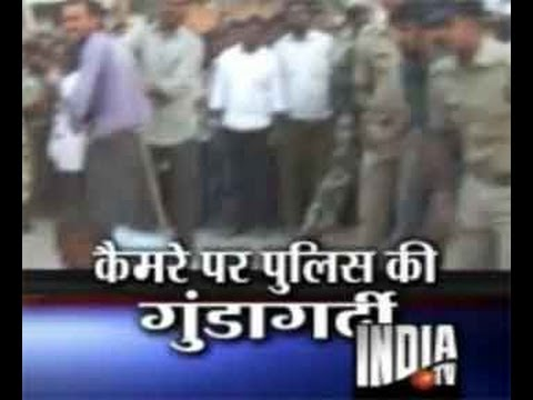 Caught On Camera: Ap Police Brutally Beats Criminals In Public - India Tv video