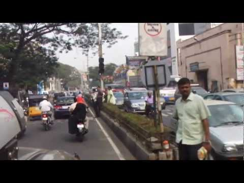 Taxi passing The Park Hotel and Chhotabhai Center, Nungambakkam, Chennai, India