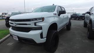 White Lifted 2019 Chevrolet Silverado Z71 Truck at the dealership | View all angles