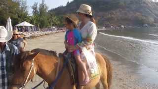 CUTE Thai Baby Girl - horse riding on beach near Hua Hin - Thailand 2014