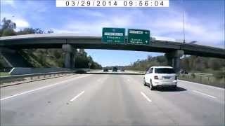 DVR-207 - Dangerous undertake by a bogan on the M1, Ormeau (Brisbane Driving Dashcam)