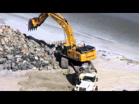 Komatsu PC750 Excavator Loading Big Rock on the Beach