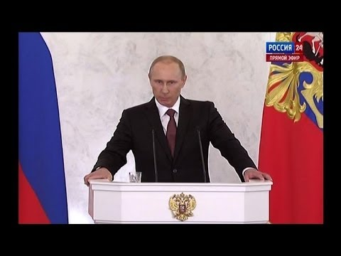 Putin signs treaty on Crimea joining Russia