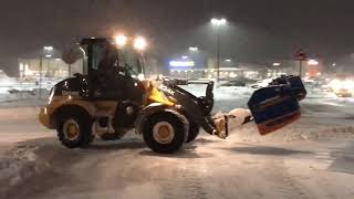 Tractors and Loaders plowing Snow