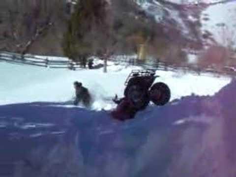 ATV WIPEOUT!   Awesome four wheeler wreck snow bailout