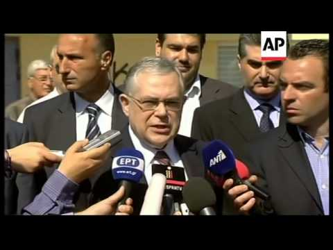 Greek PM Papademos; leaders Venizelos, Papandreou vote; comments