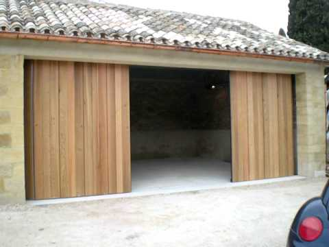 Porte de garage lat rale coulissante bois automatique crawford sodelec youtube - Portail de garage automatique ...